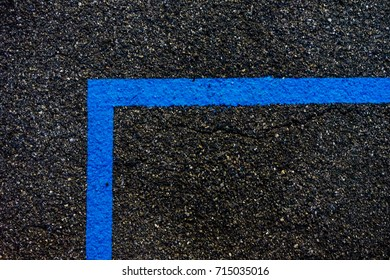 clear blue lines on concrete street close up at night