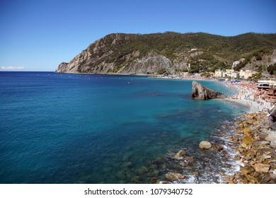Clear blue sea on rocky beach