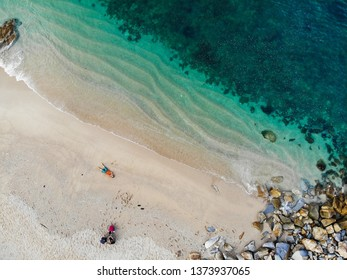 A clear blue sea on a white beach along the highway, from high angle photos