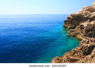 Clear blue sea and rocky coast near Odyssey cave on Island Mljet, Croatia