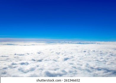 Clear blue sky above cloud layer - soft focus