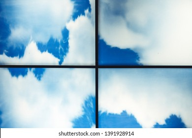 clear blue sky with clouds divided into four parts in the form of puzzles