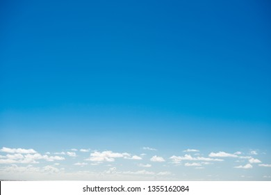 Clear blue sky with few clouds. Can be used as nature background