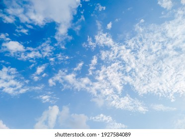 Clear blue sky with a few white clouds