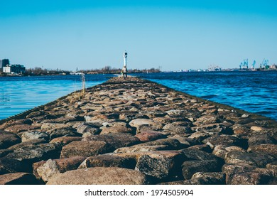 clear blue sky on the pier large stones in the foreground . High quality photo - Shutterstock ID 1974505904