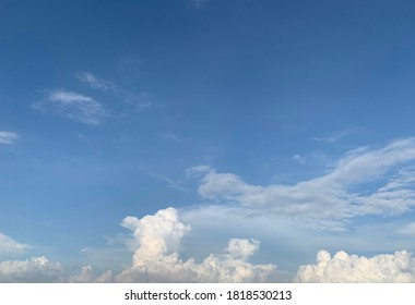 In the clear blue sky there are both Cirrus clouds and beautiful white Cumulus clouds. - Shutterstock ID 1818530213