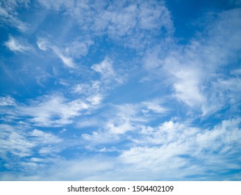 Clear blue sky with white cloud background in the morning. Good weather background.