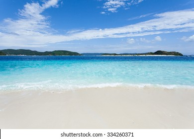 Clear blue tropical water wave lapping on white sand tropical beach, Zamami Island of the Kerama Islands National Park, Okinawa, Japan