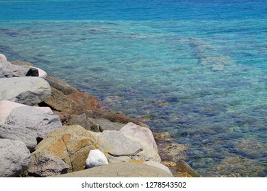 Clear blue water of the Aegean in the port of Behramkale Assos, Turkey