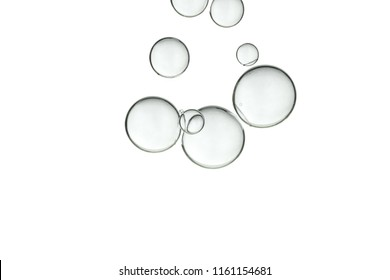 Clear bubbles soars over a white background.