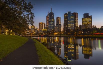 clear calm sunrise city skyline reflections Yarra river Melbourne riverbank bike path early Dawn calm water