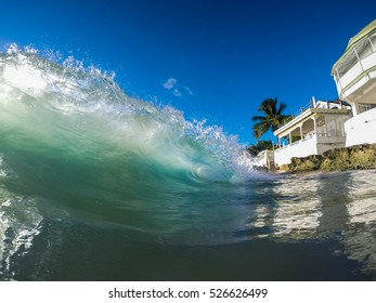 Clear colored wave rising up in a tropical sea