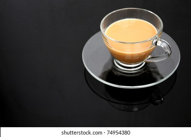 Clear cup of coffee on dark background
