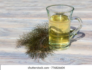 A clear cup of herbal fennel tea used in alternative medicine against intestinal diseases.