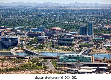 Clear day above Tempe, Arizona with the lake and downtown in the foreground and the San Tan Mountains on the distant horizon