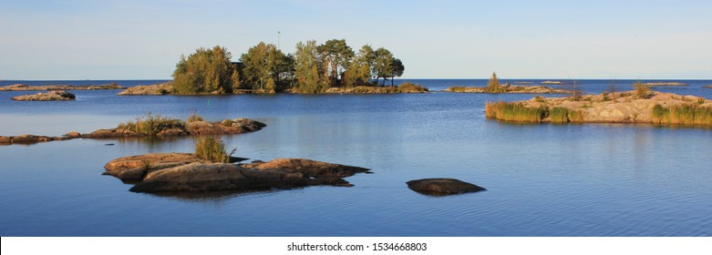 Clear day in Dalsland, Sweden. Small island and rock formations at the shore of Lake Vanern, largest lake of Sweden and the EU.