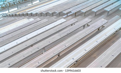 Clear DELAY : 10Simple bleachers at a sports field with seating numbers on the surface