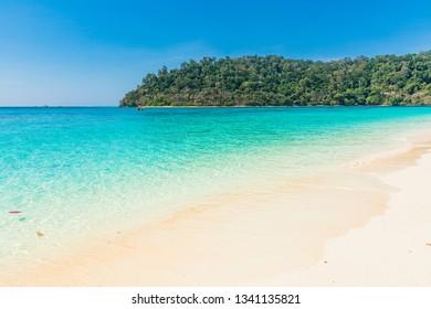 Clear emerald sea waterSurrounding the sea island with white sandy beach and blue sky at koh rok island,krabi,Thailand