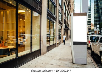 Clear empty billboard with copy space area for advertising text message or content, public information board in urban scene, street Lightbox near modern store shop window, promotional sale mock up