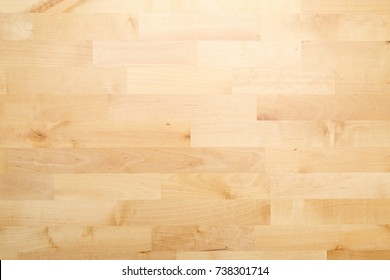 Clear and empty wooden table surface. Planked beechwood polished and covered with varnish. Nice natural pattern