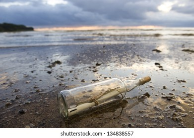 a clear glass bottle washed up on the beach, with a note inside