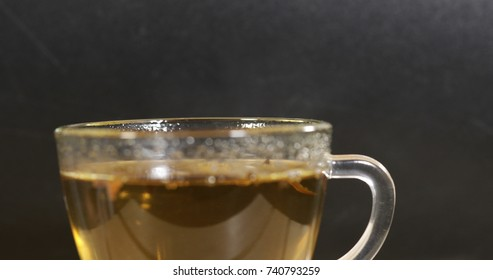 clear glass cup with brewed tea