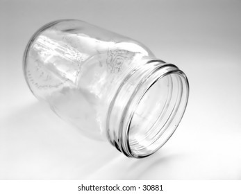 Clear glass jar isolated on white background