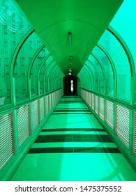 Clear green glass wall and aluminium louver panel on walkway between buildings. Selective focus. Lighting and Ventilation design concept.