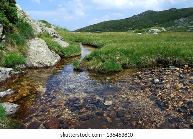 Clear high mountain spring waters in summer