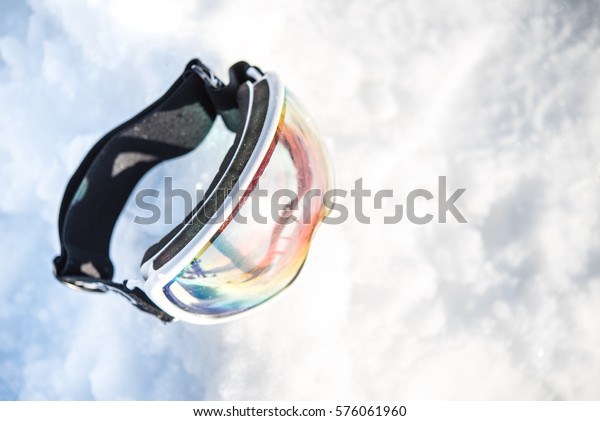 Clear Lens Ski Goggles in the Snow. Skiing Concept Photo.