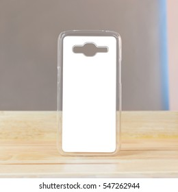 Clear mobile case on wood background in modern room. Protection smartphone object for your design.