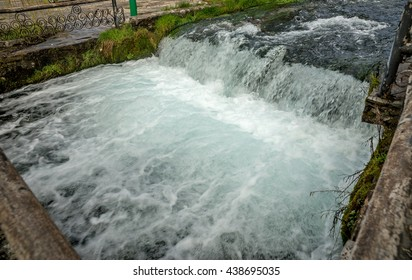 Clear mountain river in a decorated river bed with fishes