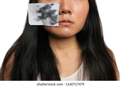 Clear oil sheet on oily skin face, tanned skin, long hair brunette in white isolated background, pore