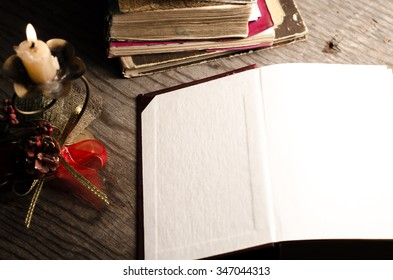 clear old book opened near burning candle,horizontal photo