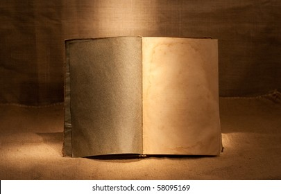 clear open book in dark room