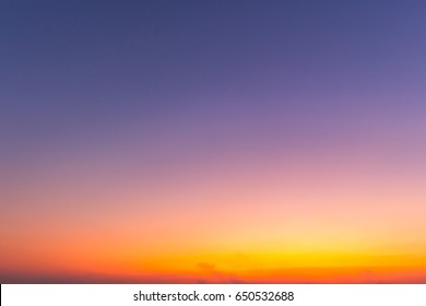 clear orange yellow sky background with blue clouds sunset or sunrise morning abstract texture.