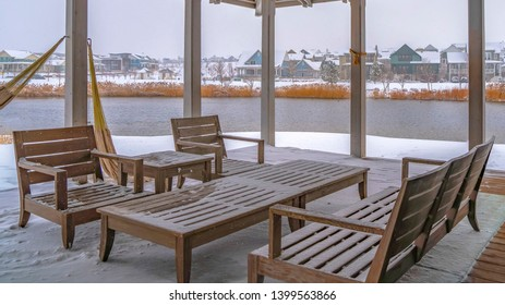 Clear Panorama Snowy patio of a clubhouse overlooking Oquirh Lake