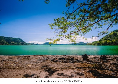 Clear and Peaceful Water of the Sano Nggoang Crater Lake in Flores, Indonesia