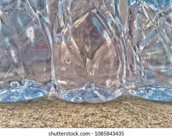 Clear plastic bottles with clean drinking water to send to the middleman.