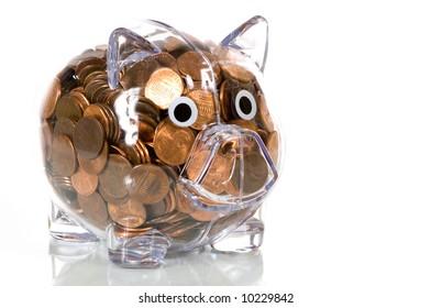 Clear plastic piggy bank stuffed full of pennies