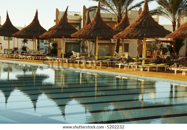 Clear pool and parasols group