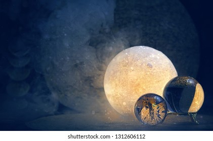 Clear quartz balls and moon lamp on dark background. Moon Ritual, modern magic, spiritual witchcraft practice - Shutterstock ID 1312606112