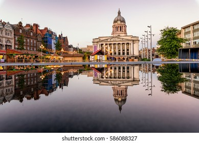 Clear reflection of a council house and market in the fountain  in Nottingham city, England.