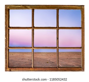 clear sky after sunset over prairie in northen Colorado as seen from a vintage sash window