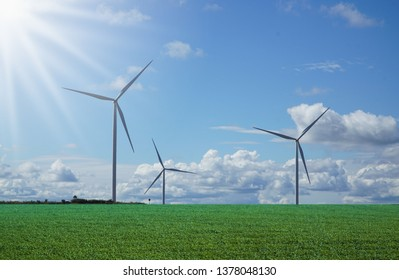 clear sky green meadow with Wind turbines generating electricity