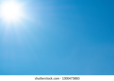 Clear sky with sun and sunrays. Daytime and good weather
