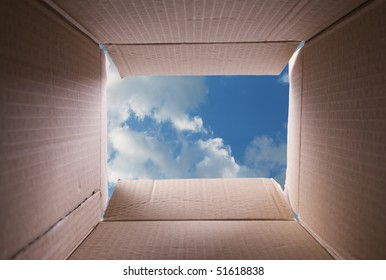clear sky, view from inside a cardboard box