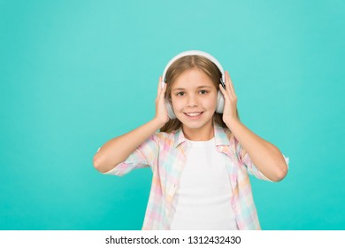 Clear sound. Girl child listen music with modern headphones. Kid little girl listen music headphones. Music account playlist. Customize your music. Listen track for dancing. Learn song lyrics.