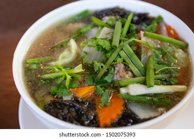 Clear soup with seaweed and minced pork. Thai food.