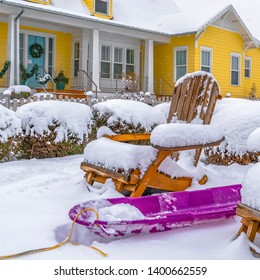 Clear Square Daybreak Utah landscape with purple sled and wooden chairs covered in snow
